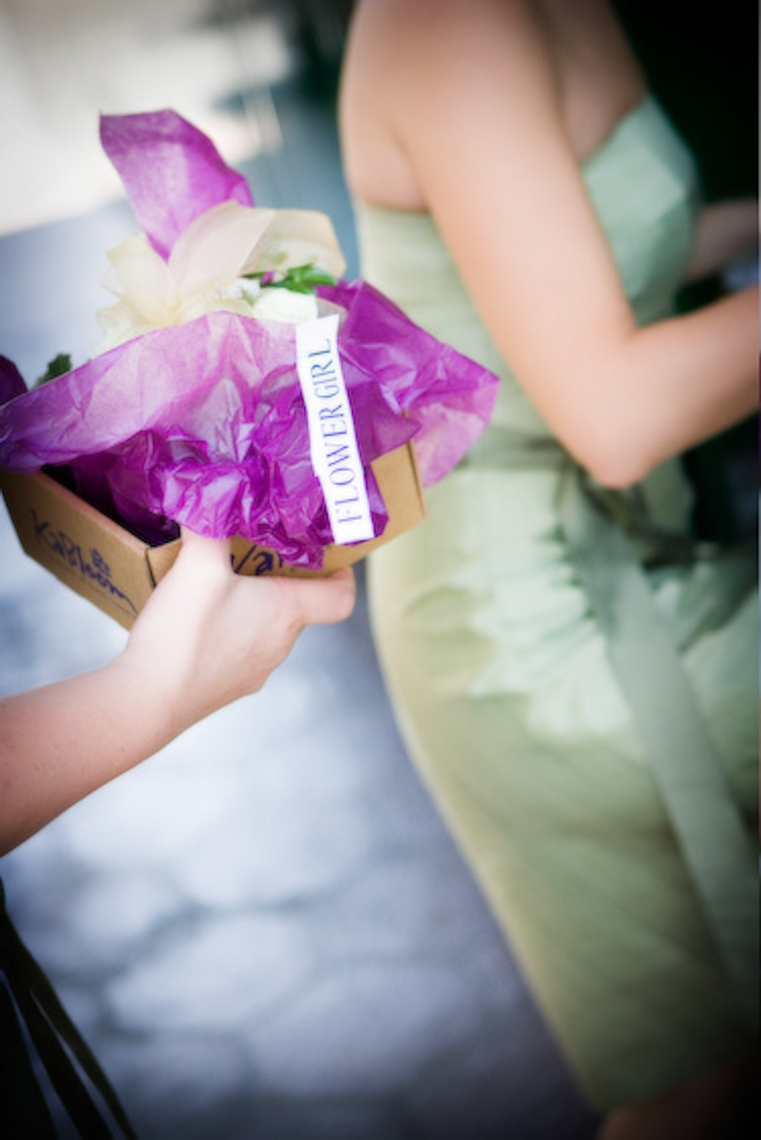 Bride's maids bouquet wrapped in purple tissue