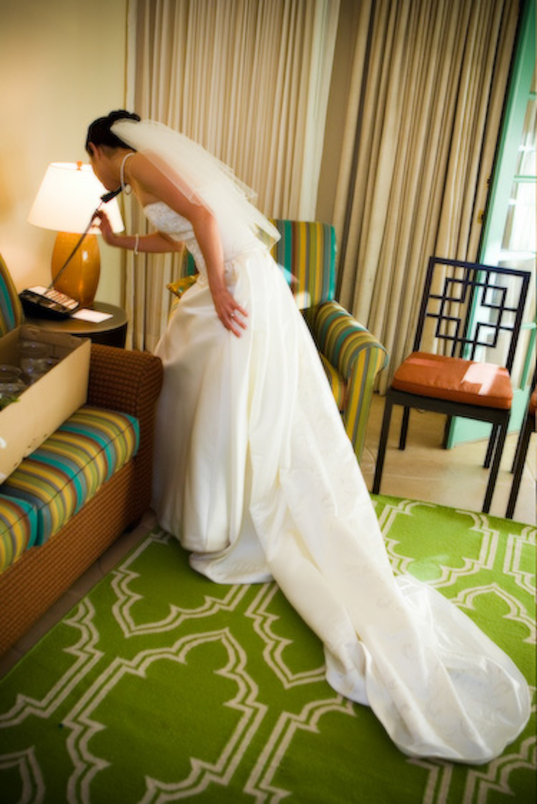 Bride making a phonecall in her room at Caleo resort in Scottsdale, AZ