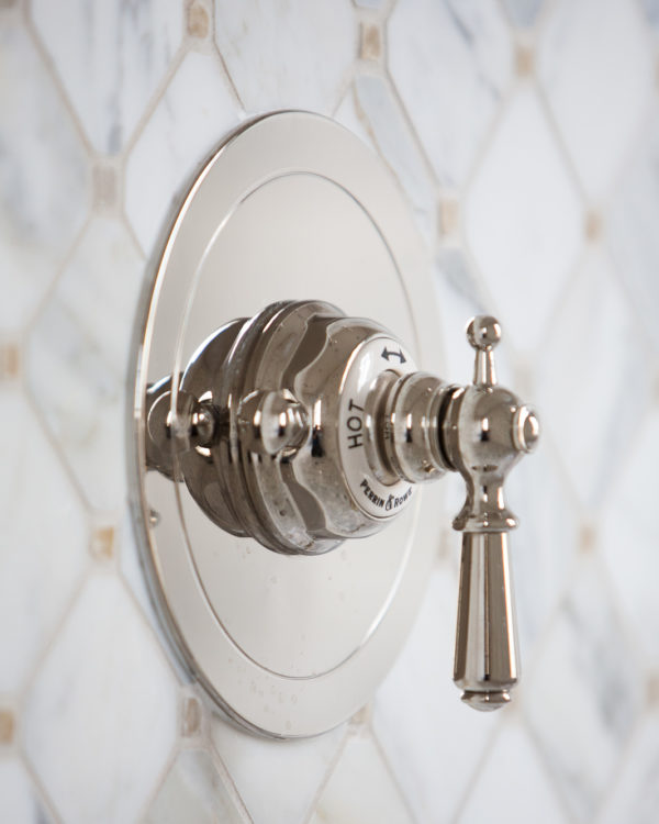 Classic style shower tap on diamond marble tile.