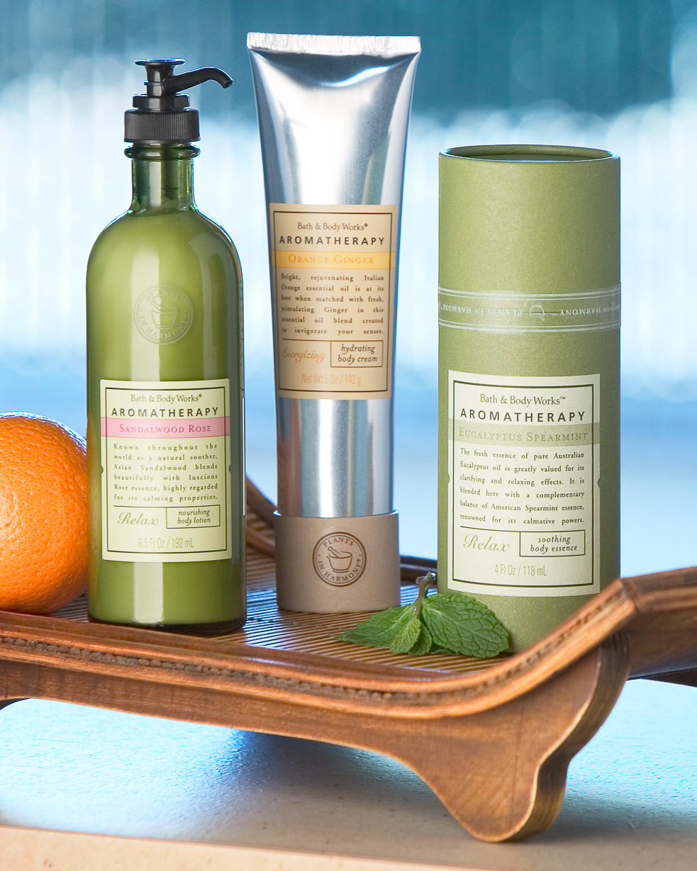 Bath and Body Works aromatherapy products on a wooden platter.